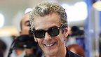 Peter Capaldi in shades, with fans