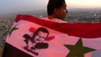 Supporter of Syria's President Assad draped in a flag