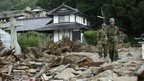 """Rescue workers from Japan""""s Ground Self Defence Force patrol at a landslide site in Hiroshima, Hiroshima Prefecture, western Japan, 22 August 2014."""