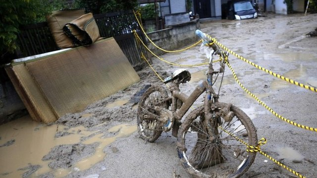 A bicycle covered with mud is seen at a site where a landslide swept through a residential area at Asaminami ward in Hiroshima, western Japan, August 22, 2014