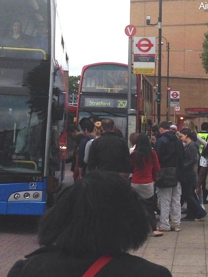 People queuing for a bus