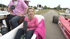 Carol Kirkwood in a motorised bathroom at a classic car festival