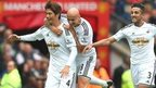 Ki Sung-yueng celebrates his goal for Swansea at Old Trafford