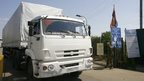 A Russian aid lorry enters Ukraine, passing a rebel sentry, 22 August