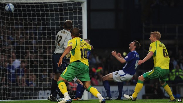 Gareth McAuley scores an own goal during the match between Ipswich and Norwich