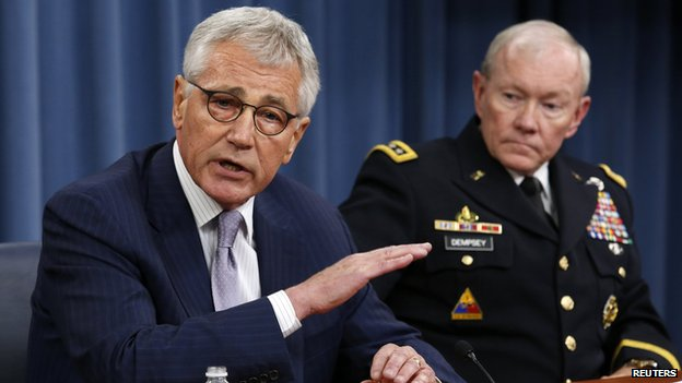 U.S. Secretary of Defense Chuck Hagel (L) speaks next to Chairman of the Joint Chiefs of Staff General Martin Dempsey during a press briefing at the Pentagon in Washington, August 21