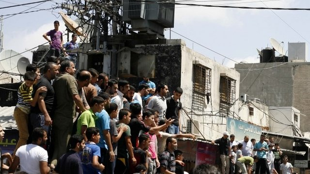 Palestinians watch as militants execute people suspected of collaborating with Israel