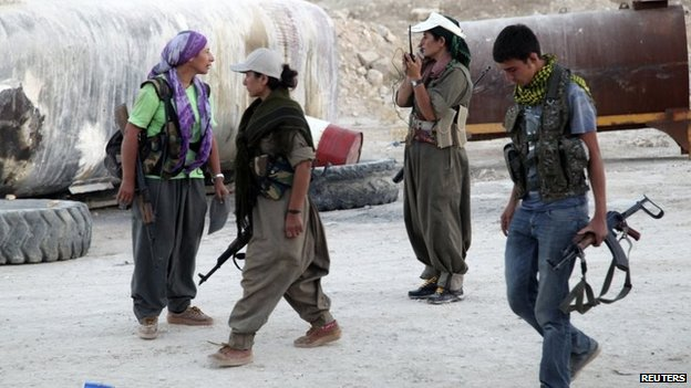 PKK fighters participate in a security deployment against Islamic State (IS) militants on the front line in Makhmur