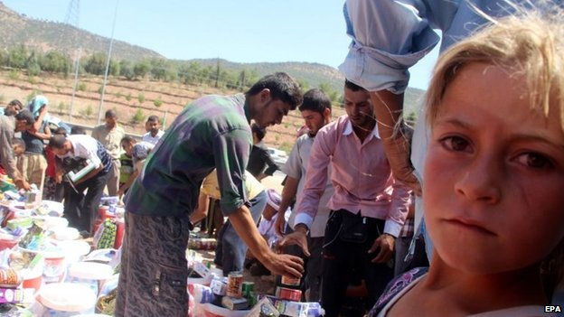 Yazidi refugees receiving humanitarian aid near Dohuk city