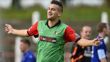 Mark Miskimmin celebrates scoring for Glentoran