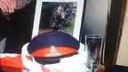 Framed picture of Andrea Martin with hat, belt and flag that have been stolen