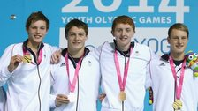 Team GB's 4x100m freestyle medley team pose with their gold medals.