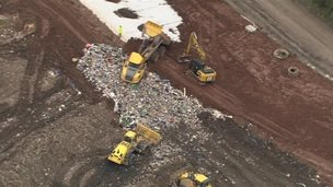 Lorries unloading waste at a landfill site