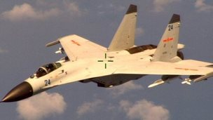 "A Chinese fighter jet that the Obama administration accuses of conducting a ""dangerous intercept"" of a US Navy surveillance and reconnaissance aircraft off the coast of China in international airspace (19 August 2014)"