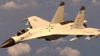 "A Chinese fighter jet that the Obama administration on Friday of conducting a ""dangerous intercept"" of a US Navy surveillance and reconnaissance aircraft off the coast of China in international airspace (19 August 2014)"