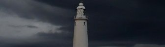 storm clouds gathering over St. Marys lighthouse in Whitley Bay