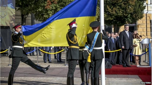 Ukraine' President Petro Poroshenko (R, on a platform) attends a ceremony for National Day in Kiev, 23 August 2014