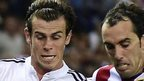 Real Madrid's Gareth Bale vies with Atletico Madrid's Uruguayan defender Diego Godin during the Spanish Super Cup final second-leg. Atletico won the tie 2-1