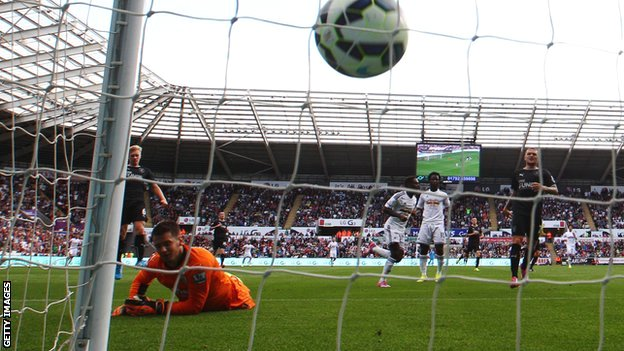 Burnley goalkeeper Tom Heaton looks on as Nathan Dyer scores for Swansea