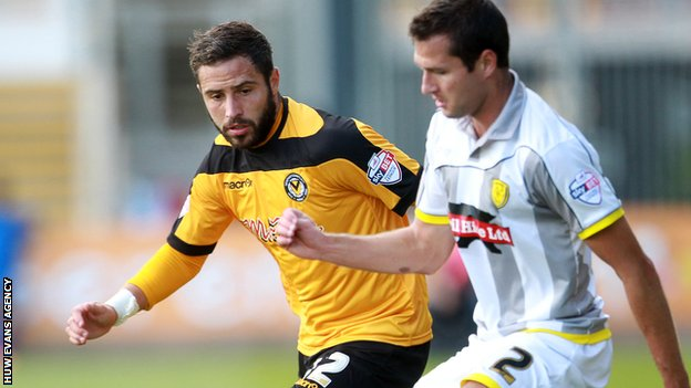 Robbie Willmott of Newport County is tackled by Phil Edwards of Burton Albion