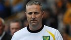 Norwich City manager Neil Adams looks on