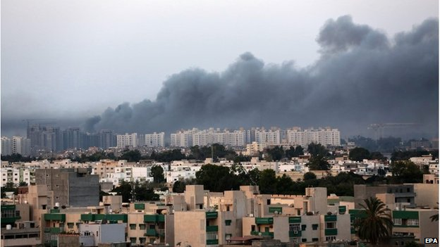 Smoke in the sky over Tripoli after fighting between militia