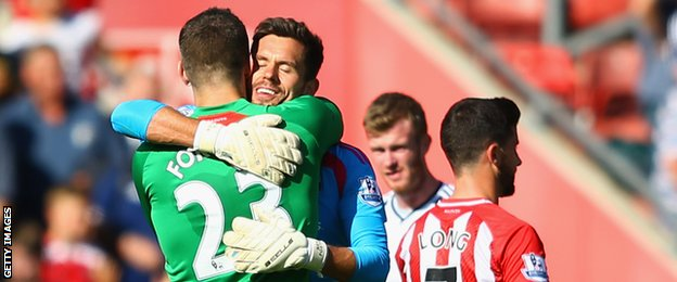 Fraser Forster of Southampton hugs Ben Foster of West Brom
