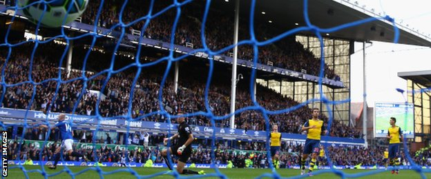 The ball hits the net as Steven Naismith wheels away in celebration