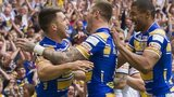 Tom Briscoe celebrates with team-mates after scoring Leeds' opening try