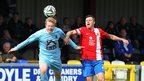 Graeme Crown clears the ball for Institute as Linfield goal-scorer Ivan Sproule looks on