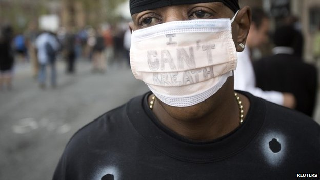"A protester wearing an ""I Can't Breathe"" face mask takes part in the ""We Will Not Go Back"" march and rally for Eric Garner in the Staten Island borough of New York (23 August 2014)"