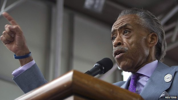 "Reverend Al Sharpton speaks on stage as he takes part in the ""We Will Not Go Back"" march and rally for Eric Garner in the Staten Island borough of New York (23 August 2014)"