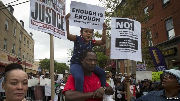 "People take part in the ""We Will Not Go Back"" march and rally for Eric Garner in the Staten Island borough of New York (23 August 2014)"