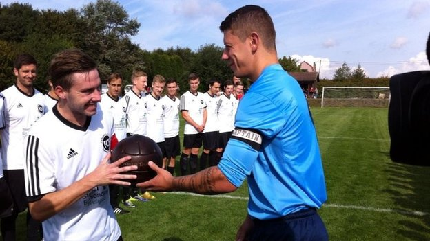 Newark captain Lewis Poole presents football