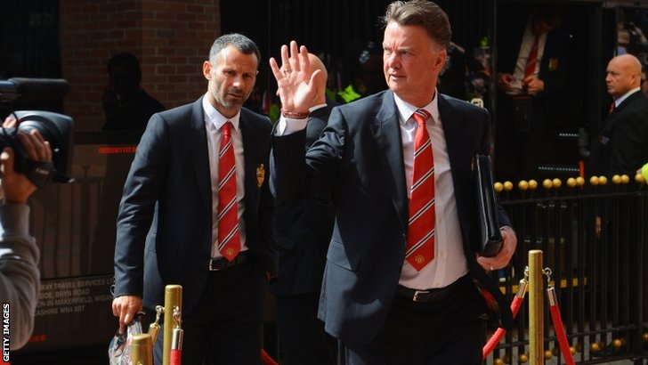 Manager Louis van Gaal and assistant Ryan Giggs of Manchester United arrive