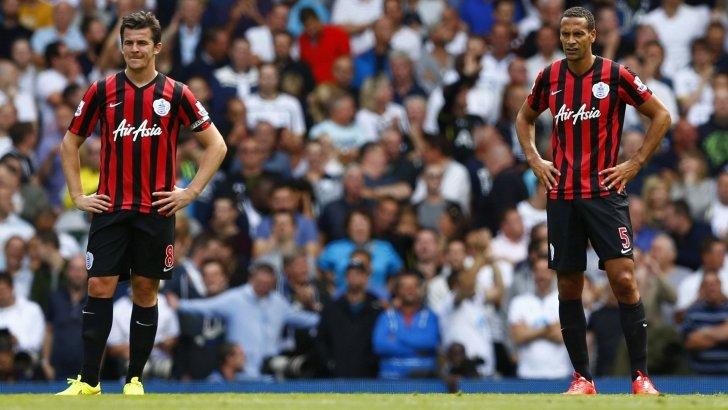 Queens Park Rangers Joey Barton and Rio Ferdinand react