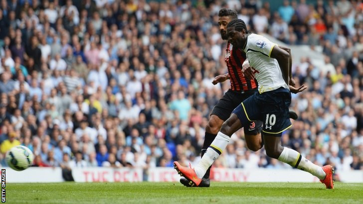 Emmanuel Adebayor of Spurs scores