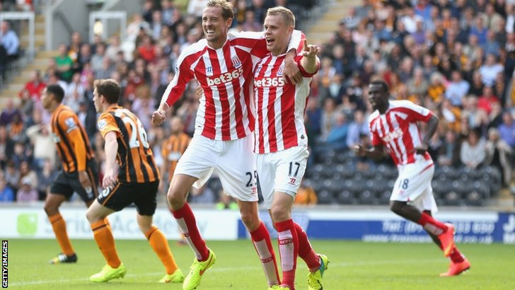 Ryan Shawcross of Stoke City celebrates with team mate Peter Crouch