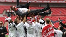Brendan Rodgers is thrown into the air by his jubilant Swansea players