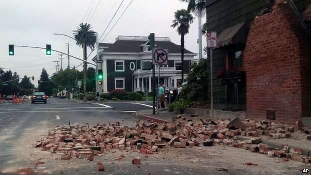 Bricks are in the street after a building was damaged during an earthquake in Napa