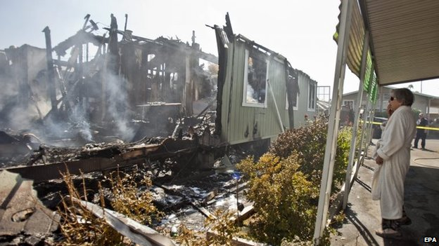 A Napa Valley resident surveys her home, destroyed by fire after the earthquake