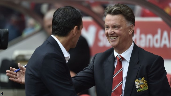 Louis Van Gaal and Sunderland's manager Gus Poyet
