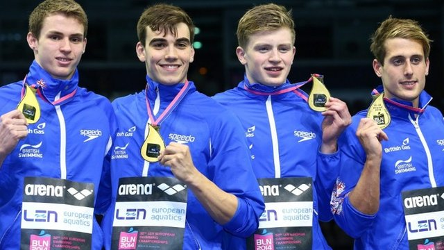 Great Britain's men's 4x100 medley relay team show off their gold medals