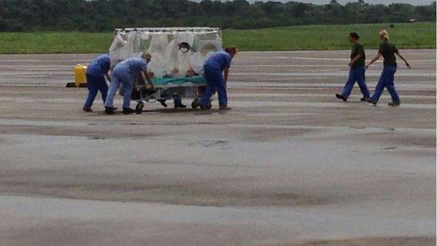 Patient on runway in Sierra Leone