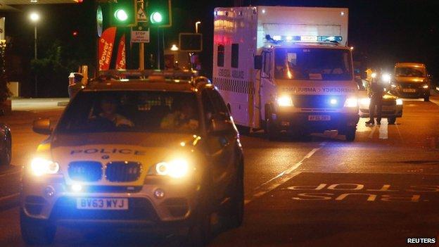 Ambulance with police escort