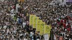 Tens of thousands of people march during an annual protest in downtown Hong Kong streets Tuesday, July 1, 2014