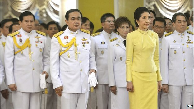 A handout photo made available by the Thai government shows Thai military junta head and newly appointed Prime Minister General Prayuth Chan-ocha with his wife Naraporn during a ceremony where he receives the royal command at the Army headquarters in Bangkok, Thailand, 25 August 2014.