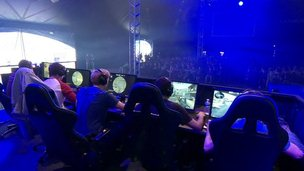Video gamers watched by crowd