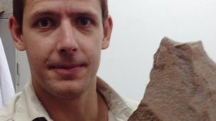 James Cole with a large handaxe
