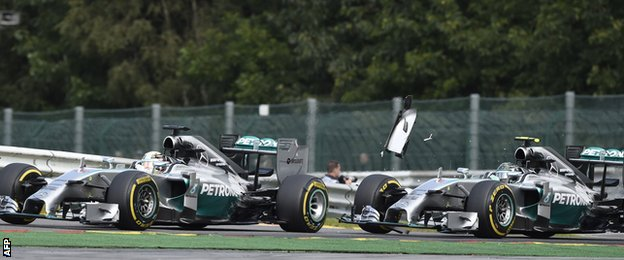 Lewis Hamilton is hit by Nico Rosberg, right